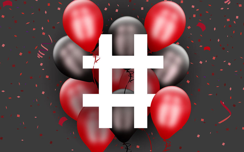 Graphic design image of a hashtag surrounded by balloons.