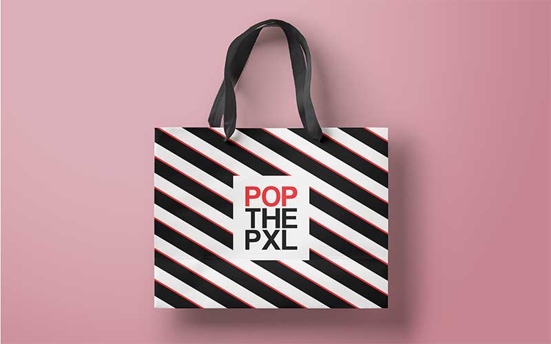 Graphic design mockup of a shopping bag for POP THE PIXEL.