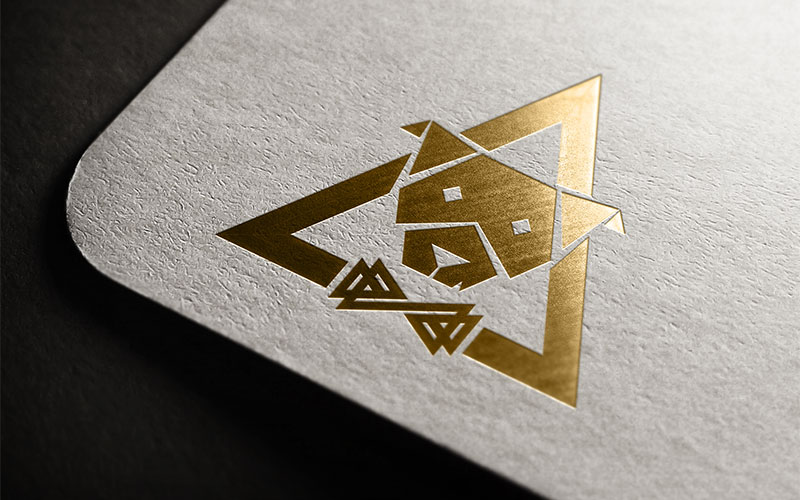 Graphic design mockup of the House of Bastien logo design printed with gold foil.