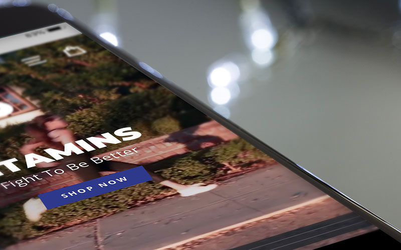 Mockup of fitamins.co, a Shopify website, on iPhone.