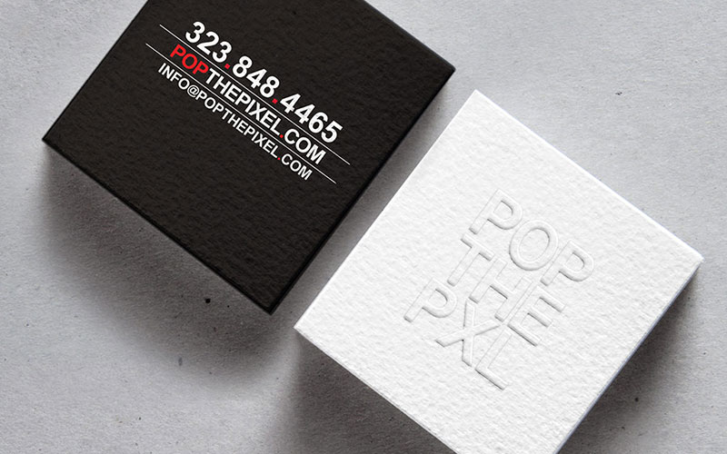 Graphic design mockup of a business card design for POP THE PIXEL.