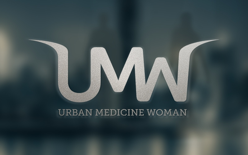 Graphic design mockup of the Urban Medicine Woman logo design as a glass door decal.