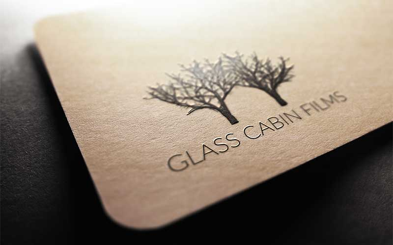 Graphic design mockup of the Glass Cabin Films logo design printed with embossing.