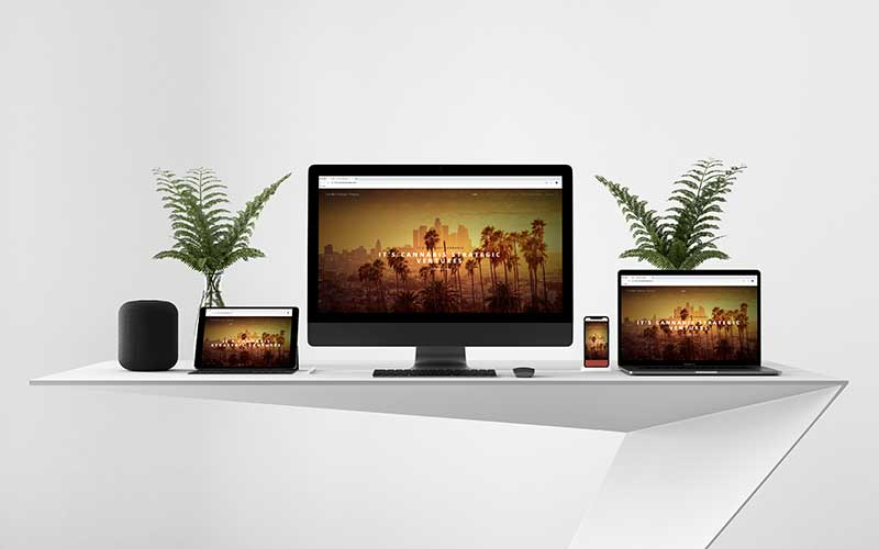 Mockup of cannabisstrategic.com, a WordPress website, on various devices.