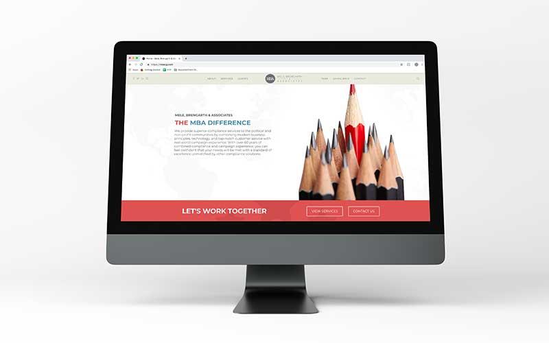 Mockup of mbacg.com, a WordPress website, on a desktop computer.